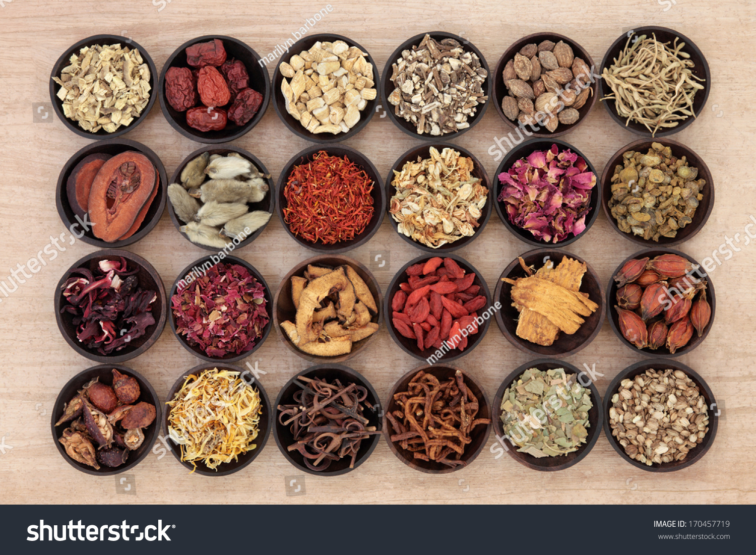 stock-photo-large-chinese-herbal-medicine-selection-in-wooden-bowls-over-papyrus-background-170457719